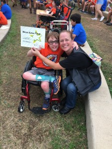 Jus-Madi with a camper during the 2015 Texas Lion's Camp Run – June 2015 | San Jacinto High Rollers MC - Katy Chapter
