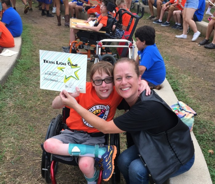 Jus-Madi with a camper at our donation check presentation during the 2015 Texas Lion's Camp Run – June 2015 | San Jacinto High Rollers MC - Katy Chapter